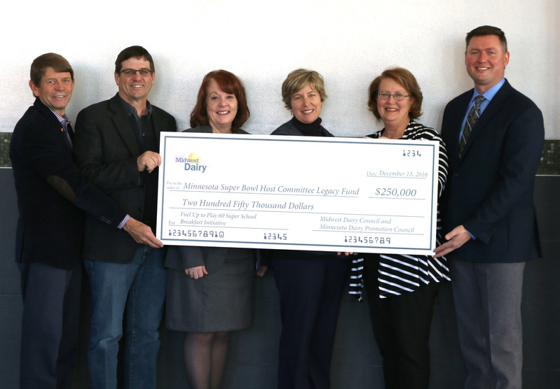 Midwest Dairy farm families have presented $250,000 to the Minnesota Super Bowl Host Committee (MNSBHC) for Super School Breakfasts. Presenting a check are: dairy farmer Ken Herbranson, Clitherall, Minn.; Jerry Messer, Midwest Dairy chairman and dairy farmer, Richardton, N.D.; Molly Pelzer, Midwest Dairy senior vice president of health and wellness; Dana Nelson, vice president of legacy for the MNSBHC; Kathy Skiba, dairy farmer, North Branch, Minn.; and Lucas Lentsch, Midwest Dairy CEO.