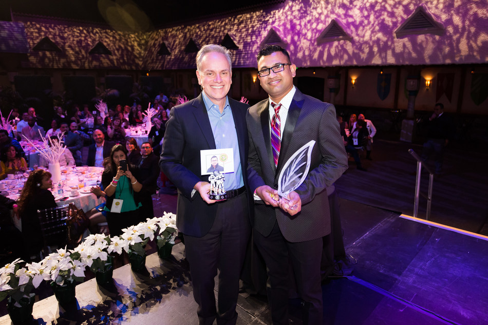 Ready Pac Foods, Inc. recently honored their top performing frontline Associates from across the country at the third annual Circle of Excellence (COE) event held at Disneyland Resort in Anaheim, Calif. Here CEO Tony Sarsam presents Prabal Dewanjee, the only three-peat winner of the program, with a COE award.