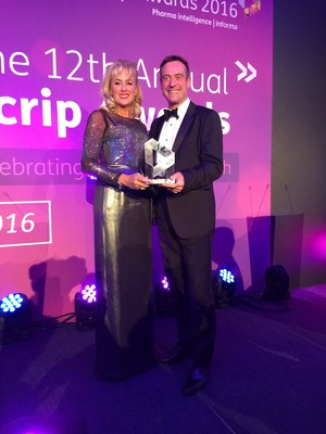 Dr. Mireille Gillings presenting the Scrip Best New Drug Award to Hugo Fry, Vice President and Chief Marketing Officer at Sanofi Pasteur MSD. HUYA Bioscience International sponsored the award at the Scrip Award gala held November 30th, 2016 at the Grosvenor House Hotel in London, UK.