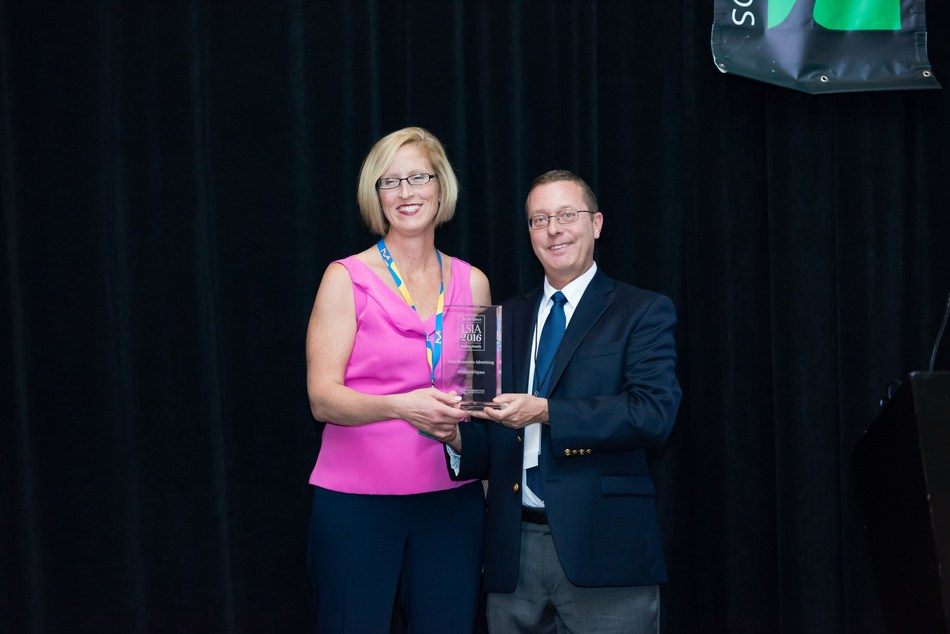 Heather Hargett, Strategic Marketing Manager, MilliporeSigma, accepts the Life Science Industry Award for Most Memorable Advertising from William Kelley, President, BioInformatics LLC, at a recent ceremony in San Diego, California