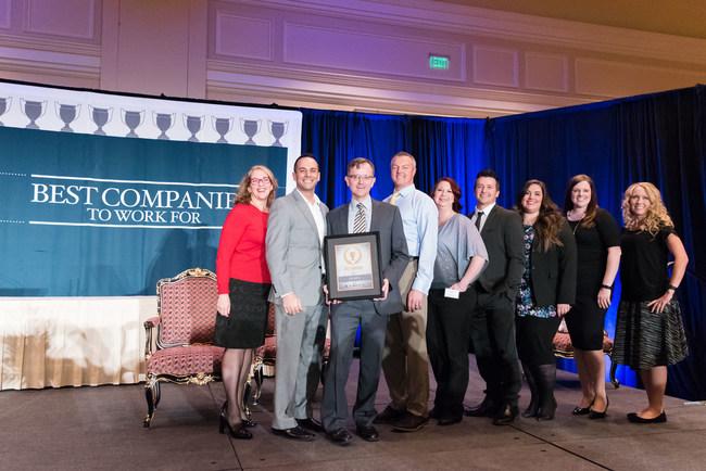 The leaders of Apex Dental receiving their Utah's Best Companies to Work For award.