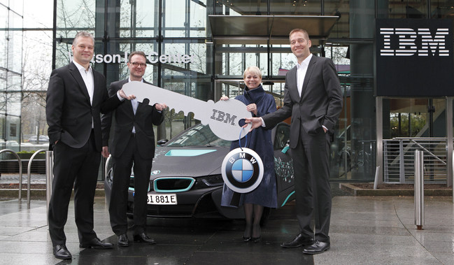 BMW Joins IBM in new Watson IoT HQ Center in Munich, Germany.  Harriet Green, Global Head of Watson IoT and Niklaus Waser, Head of Watson IoT Center in Munich present symbolic key to Marcus Raisch, Head of E-Mobility and Alexander Kraubitz, International Corporate Sales of BMW.