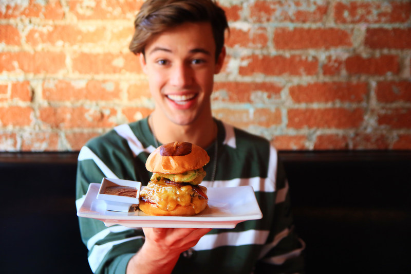 Cameron Dallas with Cameron's Dallas BBQ Burger for Umami Burger supporting Children's Hospital Los Angeles.