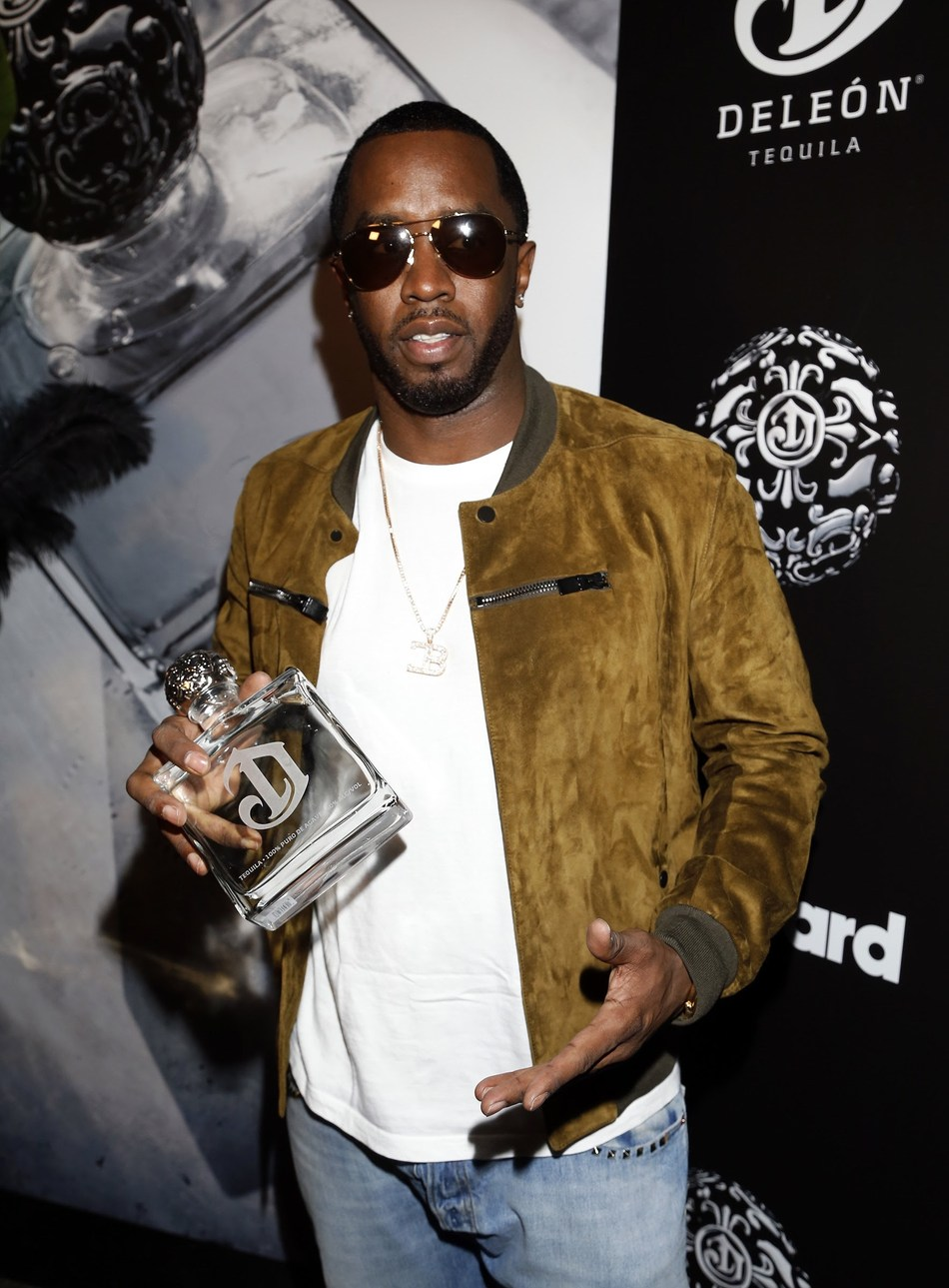 "Sean ""Diddy"" Combs and DeLeon Tequila toast to the DeLeon 100 powered by Billboard."