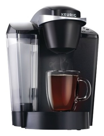 Brew a perfect beverage in under one minute with the Keurig K50 Hot Brewing System that offers a choice of three cup sizes with a removable Drip Tray to accommodate travel mugs. (CNW Group/Staples Canada Inc.)