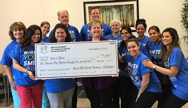Great Hill Dental partners charitable contribution check presentation to Catie's Closet