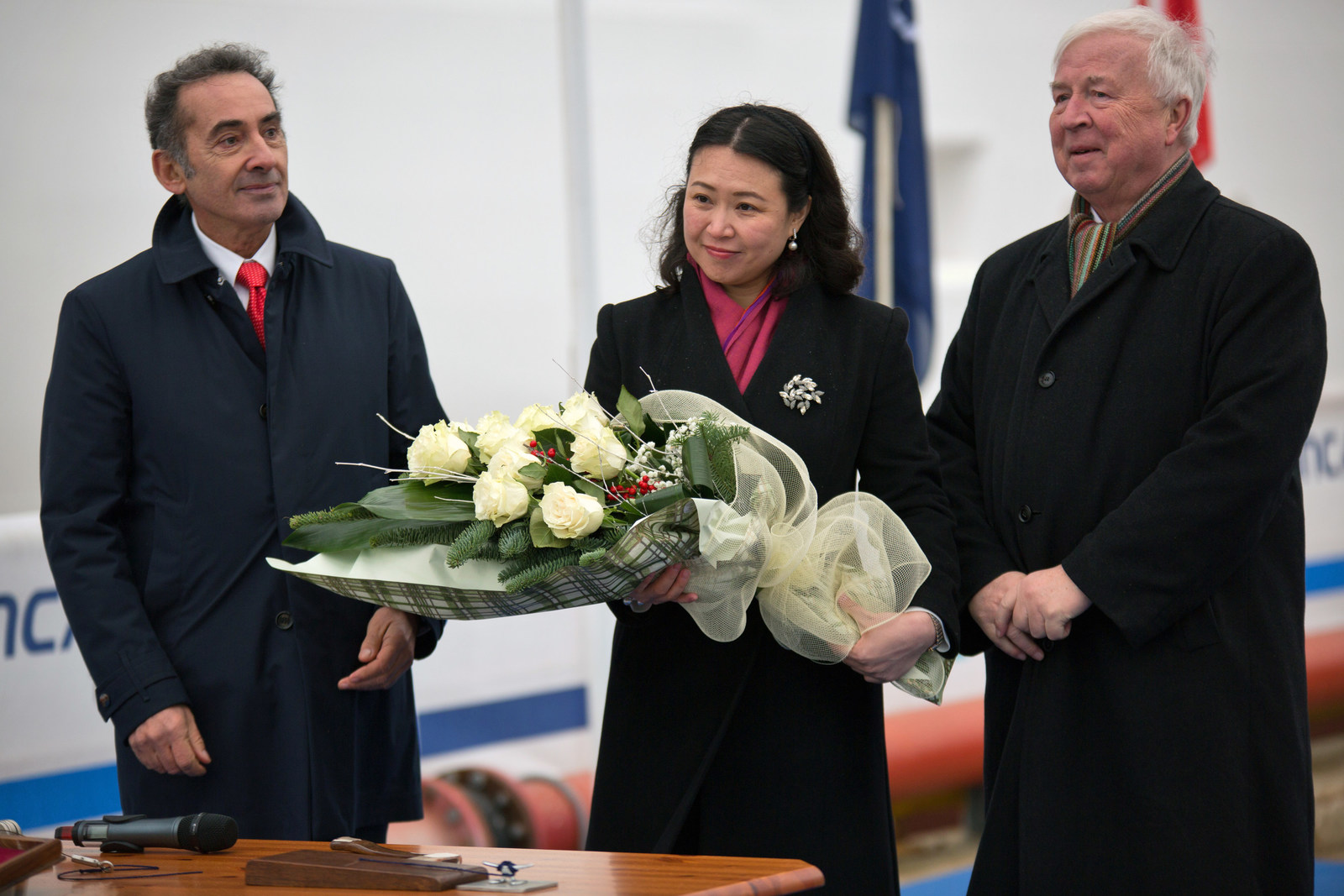 "Viking Cruises Chairman Torstein Hagen (right), with Mrs. Yi Lou, Vice President of China Merchant Bank Financial Leasing, and Fincantieri Director Giovanni Stecconi, during the ""float out"" ceremony of Viking's fourth ocean ship. Mrs. Lou served as ""madrina"" to assist with the ceremony. The 930-passenger Viking Sun will debut in late 2017. For more information visit www.vikingoceancruises.com."
