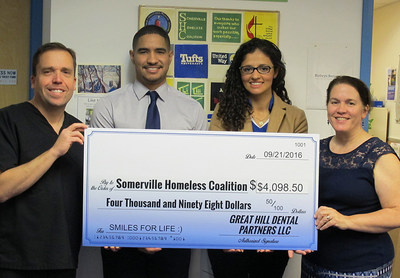Great Hill Dental in Somerville presents donation check to the Somerville Homeless Coalition
