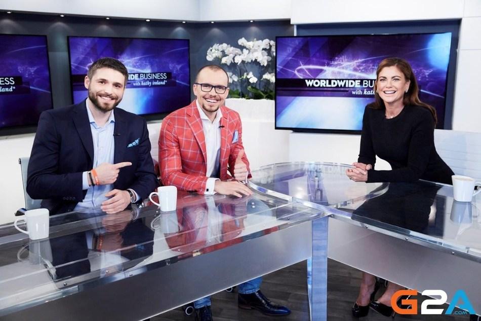 From left to right, G2A CIO Dawid Rozek and CEO Bartosz Skwarczek chatting with Kathy Ireland. (PRNewsFoto/G2A.com)