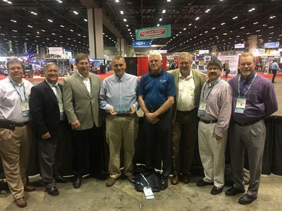 """Members of the Florida Public Utilities Company team accept the POWER-GEN International """"Best CHP Project"""" award on behalf of Chesapeake Utilities Corporation."""