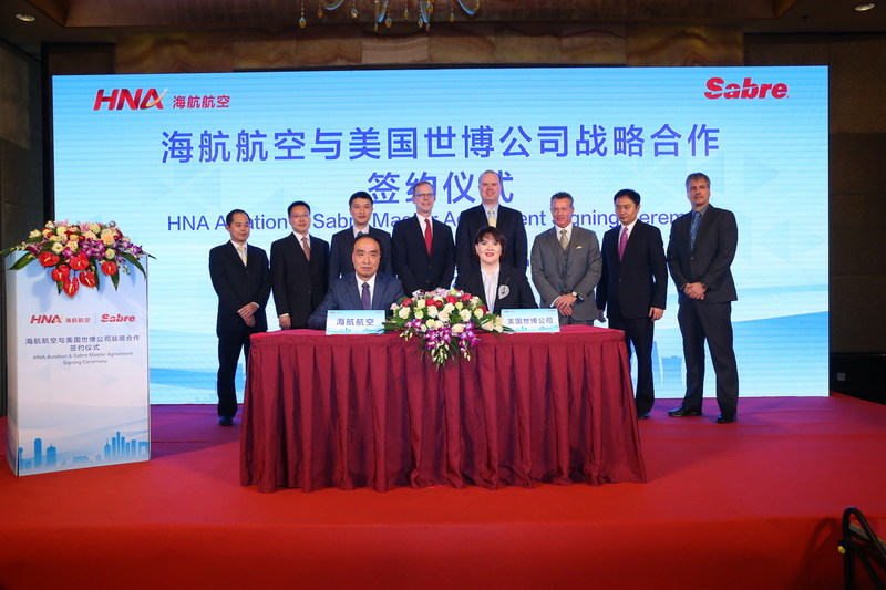 Dasha Kuksenko, Vice President and Regional General Manager APAC, Sabre signs the master agreement with He Haiyan, Information Technology Director of HNA Tourism Aviation Investment Holding Group. Behind from left to right are Zhang Wei, Wu Zhidian and Xie Haoming HNA; Scott Shaw and Steve Winkates from US Embassy; Greg Gilchrist, Peter Wu and Henning Bruns from Sabre.