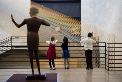 "Children experience the wonder of Gabriel Dawe's ""Plexus no. 34"" installation at the Amon Carter."