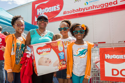 "Huggies and the Miami Dolphins team up this Diaper Need Awareness Week with the ""No Baby Unhugged"" diaper drive at Hard Rock Stadium on Sunday, Sept. 25, 2016 in Miami Gardens, Fla. (Jesus Aranguren/AP Images for Huggies)"