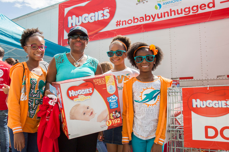 """Huggies and the Miami Dolphins team up this Diaper Need Awareness Week with the """"No Baby Unhugged"""" diaper drive at Hard Rock Stadium on Sunday, Sept. 25, 2016 in Miami Gardens, Fla. (Jesus Aranguren/AP Images for Huggies)"""
