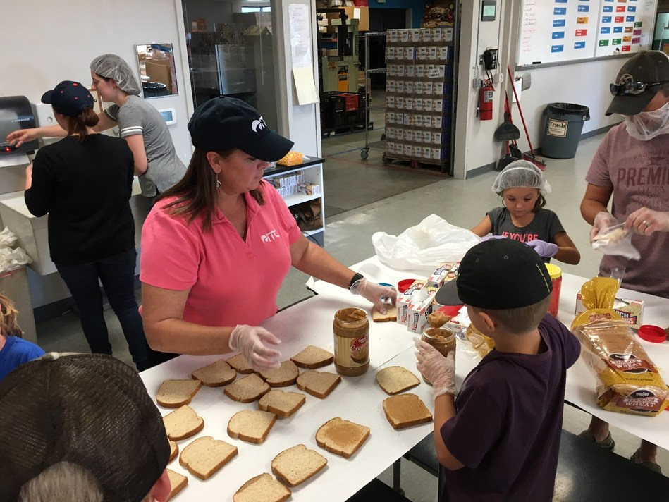 ITC's Karyn Boyd helps prepare nutritious sack suppers at Kids' Food Basket in Grand Rapids. The organization serves nearly 7,500 kids each weekday with sack suppers - well-rounded, nutritious evening meals - to attack childhood hunger to help young people learn and live well.