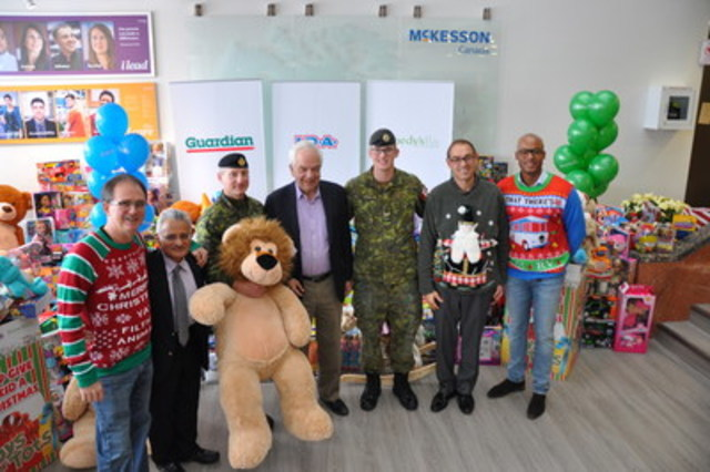 Local pharmacists, McKesson Canada employees and representatives of the Toys for Tots Canada charity were joined by the Honourable John McCallum, Canada's Minister of Immigration, Refugees and Citizenship. (CNW Group/MCKESSON CANADA)