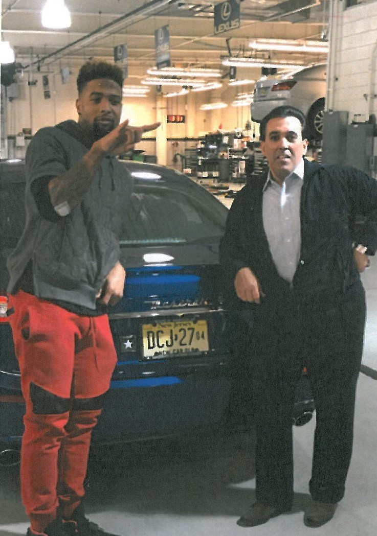 Odell Beckham, Jr., on the right, with Celebrity Motor Car Principal and Owner Tom Maoli.