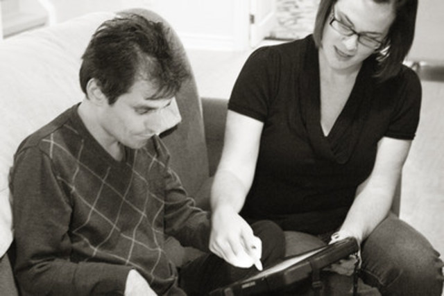 John and an Intervenor using Facilitated Typing (CNW Group/DeafBlind Ontario Services)