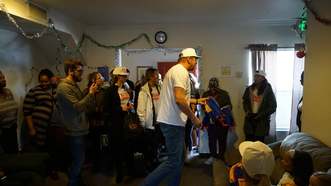 """BigMike handing out backpacks at a Family Shelter run by Volunteers of America in Los Angeles."