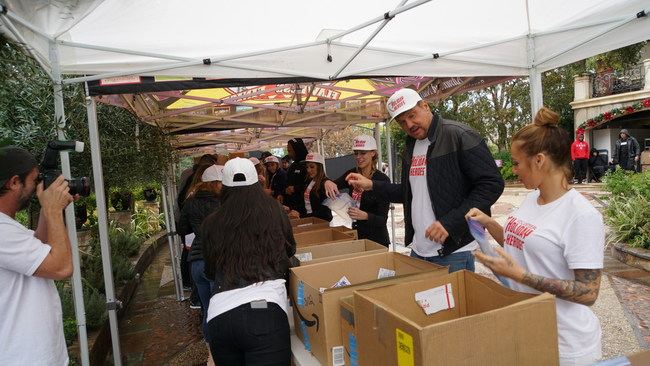 BigMike helps over volunteers and staff pack backpacks full of necessities for LA's homeless community.
