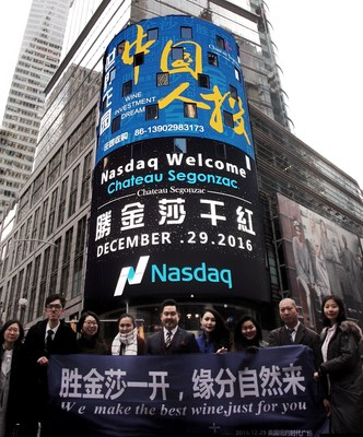 Shareholders of Chateau Segonzac International Group Co. Ltd. pose for a group photo in front of the NASDAQ LED billboard in New York City.