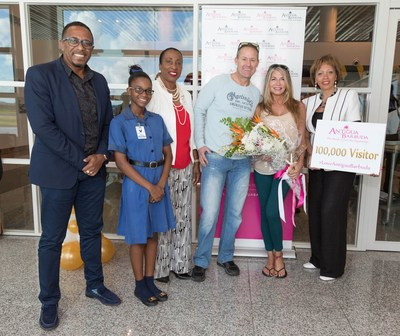 From left: ABTA CEO, Mr. James, Tourism Cadet, Alicia Paul, Tourism Consultant Ms. Nibbs, 100,000th visitors Greg Murphy and Jean Larsen, US Director of Tourism, Ms. Jack Riley.