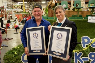 (L-R) Joey Herrick, founder of Lucy Pet Products and Lucy Pet Foundation, and Kim Partrick, Guinness World Record adjudicator display Guinness World Record certificates for longest and heaviest float in history ... Lucy Pet's Gnarly Crankin' K9 Wave Maker 2017 Tournament of Roses Parade float is 126 feet long and weighs 148,250 lbs.