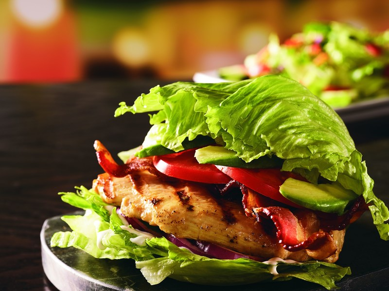 Red Robin Gourmet Burgers and Brews' new Avocado Chicken Wedgie is a flavor-packed 360-calorie powerhouse featuring a fire-grilled chicken breast, bacon, avocado, tomatoes, red onions and ranch dressing on a lettuce bun.