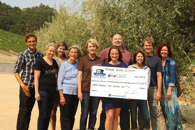 The Niner Wine Estates team presents a check of $11,400 to GleanSLO members at their tasting room. GleanSLO is one of the San Luis Obispo County organizations that received a donation from the winery in 2016.