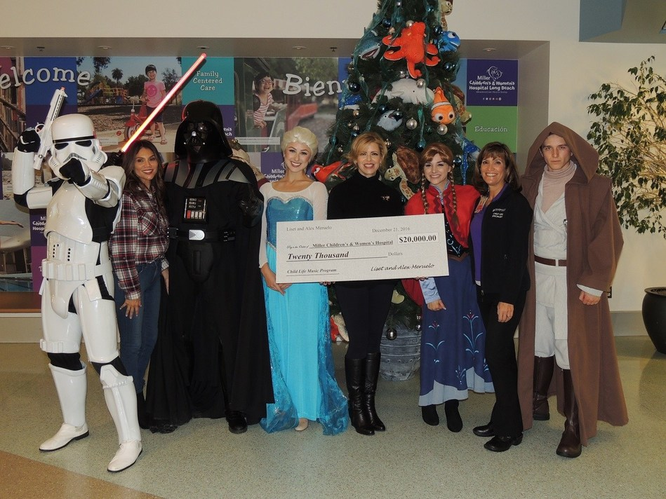 Liset Meruelo presents a check for $20,000 to expand the Music Therapy Program at Miller Children's & Women's Hospital Long Beach.