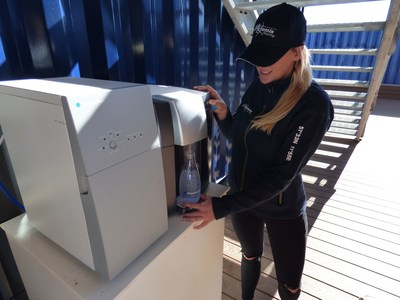 Artemis Racing team member helps herself to a refreshing glass of harvested rainwater water purified by Bluewater.
