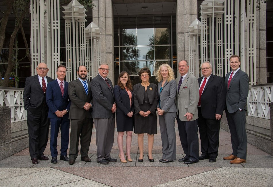 (Left to right - Gary Walker, Mark Bentley, Jeffrey Gad, Joseph Rugg, Jamie Klapholz, Cynthia Mikos, Yvette Rhodes, William Kalish, Vitauts Gulbis and Patrick Traber outside the new Tampa office location at the SunTrust Bank Building