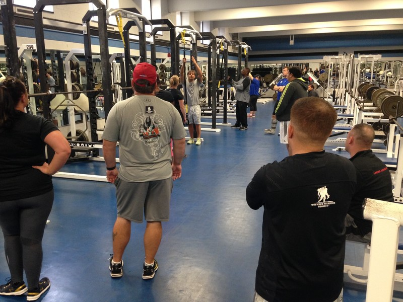 Warriors receive instructions on weight training, during a recent physical health and wellness event hosted by Wounded Warrior Project and Johns Hopkins University.