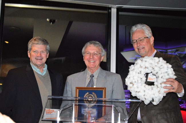 The 2017 Extension Cotton Specialist of the Year, Dr. Robert Hutmacher (center), of the University of California, is congratulated by Steve Nichols (left), Bayer head of Agronomic Services - Seeds, and Monty Christian (right), Bayer vice-president of U.S. Cotton Operations. Bayer sponsors the annual award dinner during the Beltwide Cotton Conference, held this year in Dallas on Jan. 5.