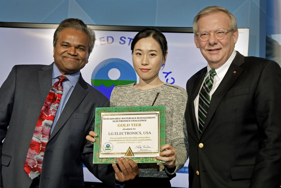 Obama Administration official Mathy Stanislaus, Assistant Administrator for EPA's Office of Land and Emergency Management, Jane Kang, Head of Product Stewardship, LG U.S., John Taylor, Vice President of Public Affairs, LG U.S., Receiving EPA Gold Tier Recycling Award