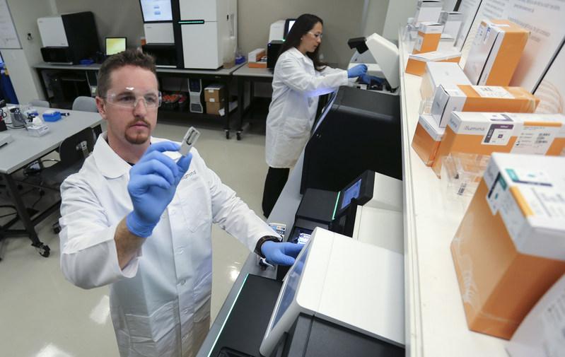 Scientists preparing Illumina NGS platforms.