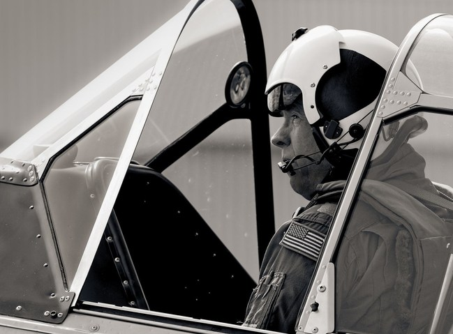 Jeff Geer President and Chairman of the BRAVO 369 Flight Foundation in the cockpit of the North American Aviation T-6G Texan