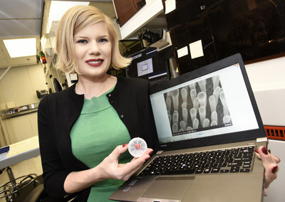 """IBM inventors break US patent record with 8,088 patents granted in 2016, the company's 24th consecutive year of patent leadership. Master Inventor Emily Kinser, co-inventor on three patents granted to IBM in 2016, with next-generation 3D nanostructure shown at 100,000x magnification, inspired by US Patent #9,406,561, an invention that enables computer chips stacked on top of each other directly with no interface, a process called """"3D Integration."""" (Photo Credit: Michael Pollio/Feature Photo)"""