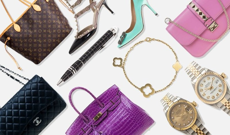 pre-owned luxury items (PRNewsFoto/The Luxury Closet)