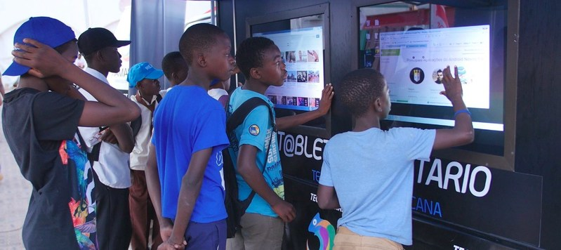 Youth in Mozambique using the Community Tablet.