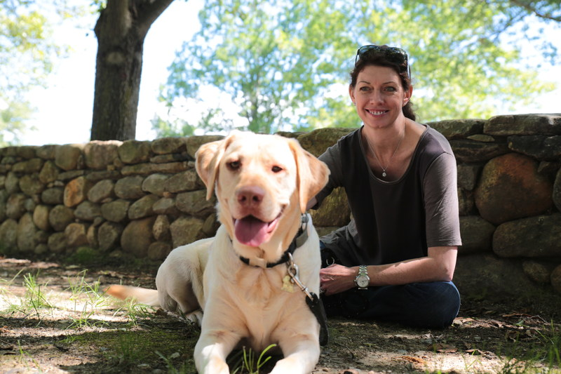 Camelle Kent, WellPet CEO, pictured with her dog Rommel at WellPet's Tewksbury, Mass. headquarters.
