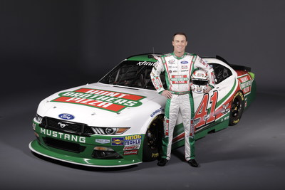 Kevin Harvick in front of his #41 Ford Mustang.