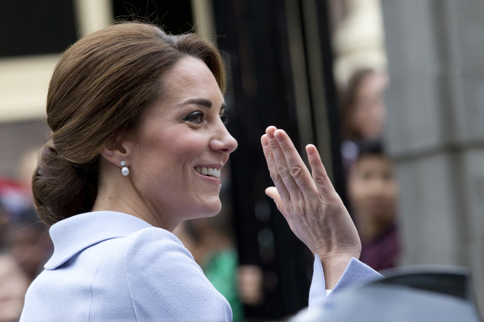 Britain's Kate, the Duchess of Cambridge, greets well-wishers as she arrives at the Mauritshuis Museum in The Hague, Netherlands, Tuesday, Oct. 11, 2016. (AP Photo/Peter Dejong) (PRNewsFoto/Shutterstock, Inc.)