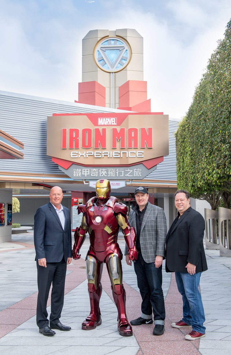 Bob Chapek, chairman of Walt Disney Parks and Resorts (left), Kevin Feige, president of Marvel Studios, and Joe Quesada, chief creative officer for Marvel Entertainment (right) join Iron Man for the grand opening of Iron Man Experience - Presented by AIA at Hong Kong Disneyland.  The attraction is Disney Parks' first-ever Marvel-themed ride.