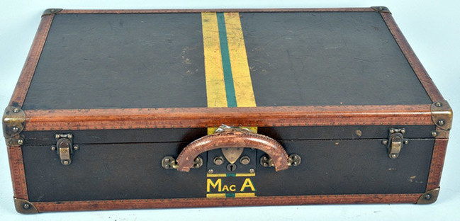 One of three Louis Vuitton suitcases owned by and monogrammed for Gen. Douglas MacArthur, each accompanied by a COA from the Louis Vuitton Museum in Paris, estimate $6,000-$10,000