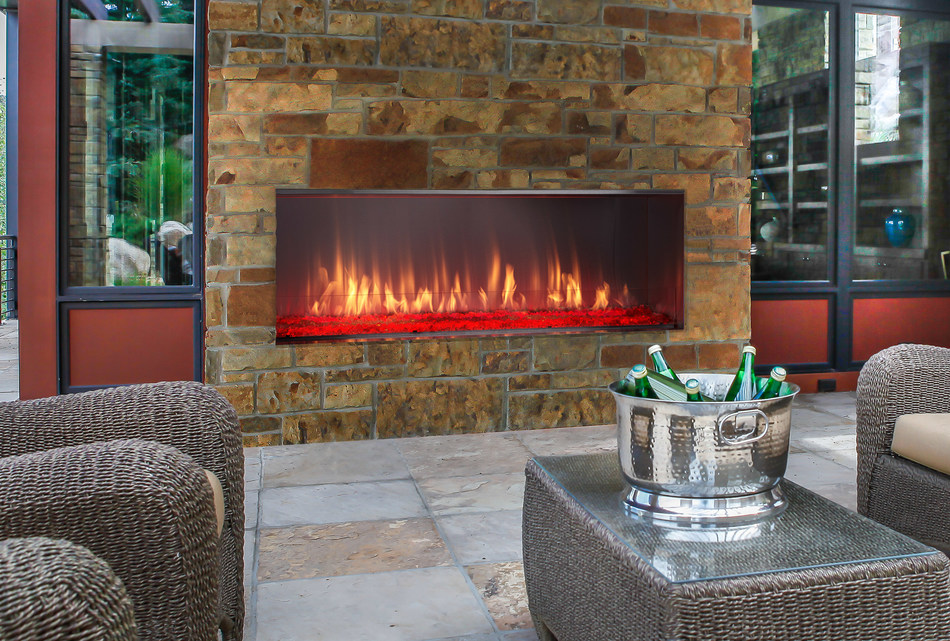 Offering contemporary style with a colorful firebed, the Lanai outdoor gas fireplace is the perfect centerpiece to enhance your exterior room. At 51 inches wide, it features rust-resistant stainless steel construction, including a stainless steel interior that reflects and magnifies the flame, as well as a glass wind guard to protect those flames and keep them full and lively.