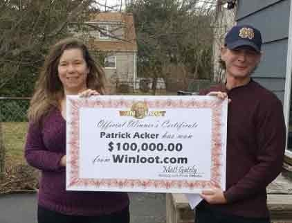 Patrick Acker and his girlfriend showing off the Big Check before heading to the bank to cash the real thing for $100,000