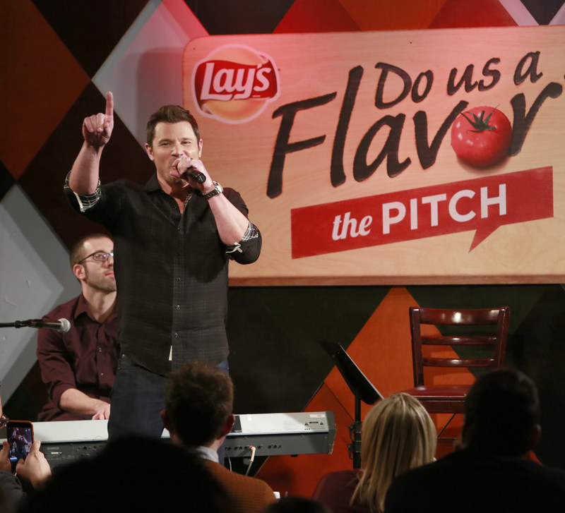 """Multiplatinum recording artists Nick and Drew Lachey """"pitch"""" their flavors to a live audience at Carolines on Broadway, announcing Lay's """"Do Us a Flavor"""" 2017 Monday, Jan. 9, 2017 in New York. The latest installment, """"The Pitch,"""" invites fans to simply pitch the inspiration behind their best flavor ideas. Fans can submit their pitches starting today at Lays.com. (Photo by Mark Von Holden/Invision for Lay's/AP Images)"""