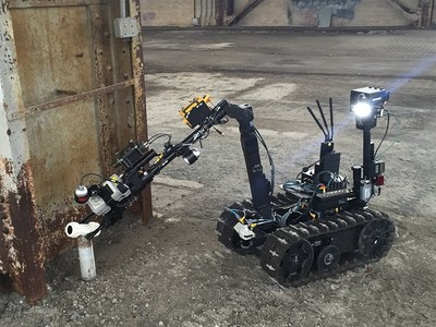 QinetiQ North America's TALON tactical robot shown with Persistent System's MANET radio.