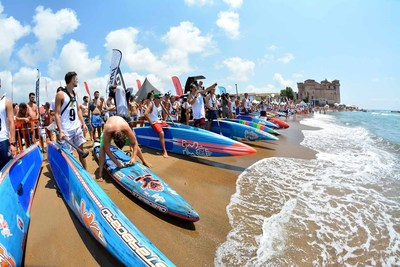 Crowds pack the beach to watch the athletes of The Waterman League professional paddlesurfing racing and surfing league compete in a recent competition.